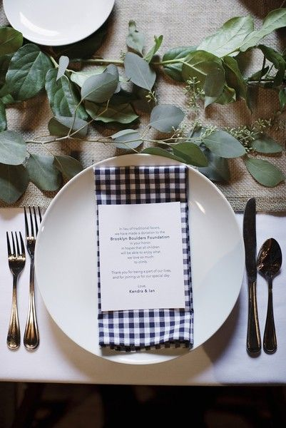 Modern, rustic-chic wedding reception decor idea - classic white dinner plates, navy gingham napkins + fresh green garland table runners {Photo by Basia}
