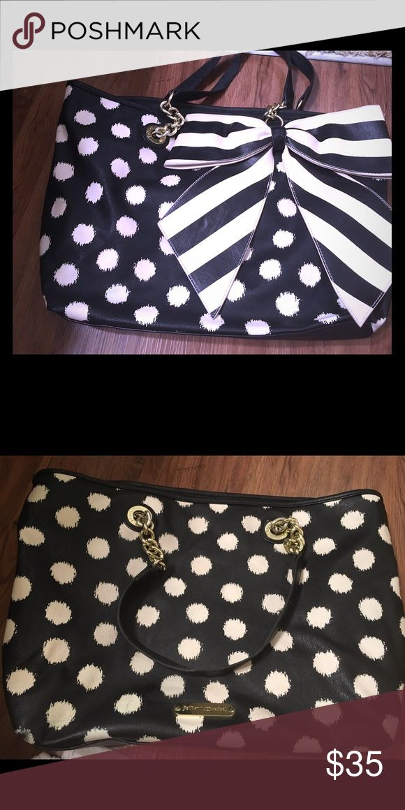 Betsy Johnson Black and white Polka dot tote bag Black and white Polka dot Betsy Johnson tote bag come standard with the signature oversized bow. Betsey Johnson Bags Totes
