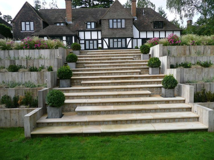 If you're struggling with height differences in your garden, add a dramatic stairway like this garden by Robert Field and John Nash who chose our Buff Sandstone Paving for the job.