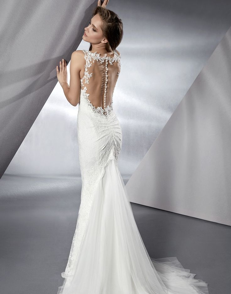 BOBBI // Gorgeous Bobbi is a mermaid wedding dress with a plunging neckline and a low illusion back finished with the most intricate hand beaded details