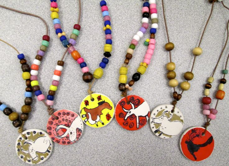 Paleolithic Necklaces by Fourth Grade http://lsartatkinkaid.blogspot.com/2013/10/art-history-unit-1-cave-art-at-lascaux.html