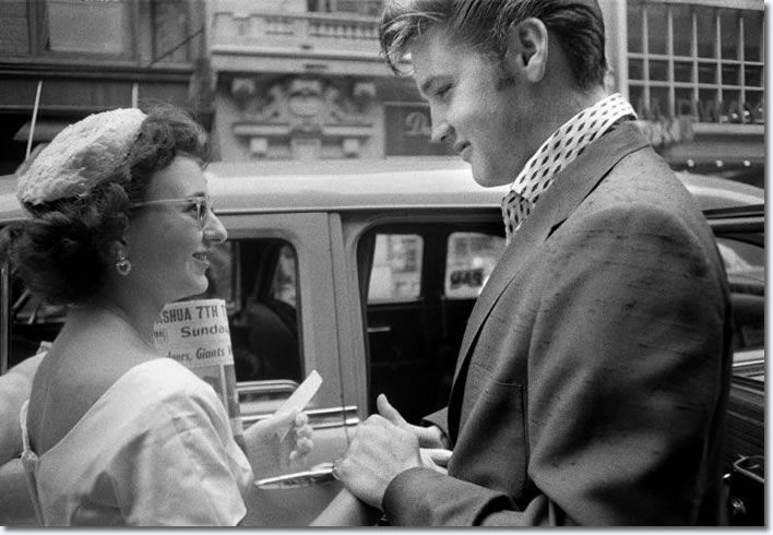 July 1, 1956 arrived at the Hudson Theater in New York City to perform on the Steve Allen comedy show, Elvis is greeted by a female fan who had come all the way in from Long Island to meet her idol. (New York City, July 1, 1956)
