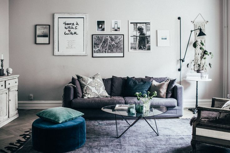 Beautiful soft grey walls and muted furnishings with a pop of colour in the ottoman. Rustic white dresser and black and white wall gallery. This room is heaven! Johanna Bradford Kristin Lagerqvist