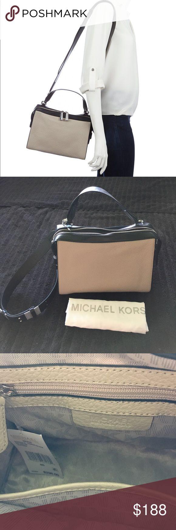 Michael Kors Ingrid Cement Black Bag NWT Michael Kors Ingrid Medium Cement Gray and Black Leather. NWT with dust bag. Authentic. MICHAEL Michael Kors Bags Shoulder Bags