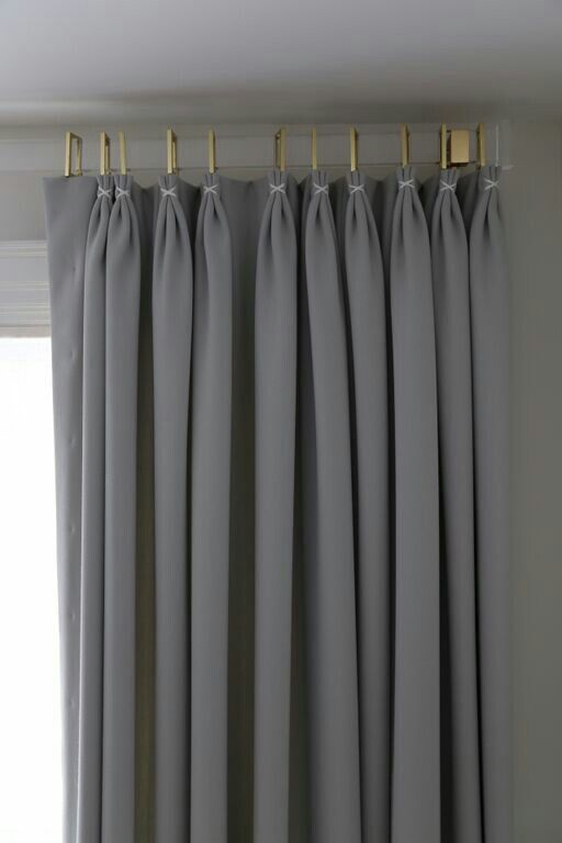 acrylic drapery rod with euro pleated drapery