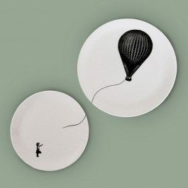 The curse of helium, your hot air balloon always flies away… This is a uniquely surreal original illustration by Eleanor Stuart featuring a girl who has lost her hot air balloon. Designed across two plates, the balloon can be placed further away from the girl to appear as if her balloon has flown far far away... Each illustration is silk-screen printed and decorated by hand on to beautiful coupe fine bone china plates in Stoke-on-Trent.  This design is a pair of plates, a large ...