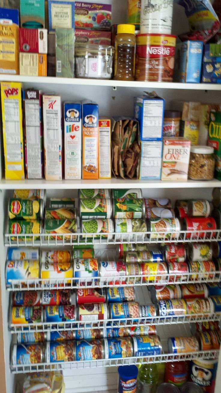 How to organize canned goods - wire shelves flipped upside down at an angle. Love this!