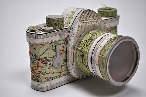 UK artist Jennifer Collier makes intricate, detailed, and accurate replicas of shoes, cameras, garments, and other household items out of stitched paper. Part of the strength of her work is her careful choices for paper, utilizing musical notes, vintage images, and printed patterns to great effect.