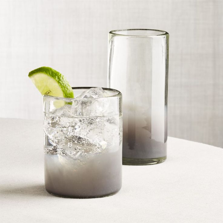 Shop Fog Drinking Glasses. Transitioning from opaque to clear grey, our artisan-crafted glass elevates the look of recycled glass with a contemporary, two-tone design.
