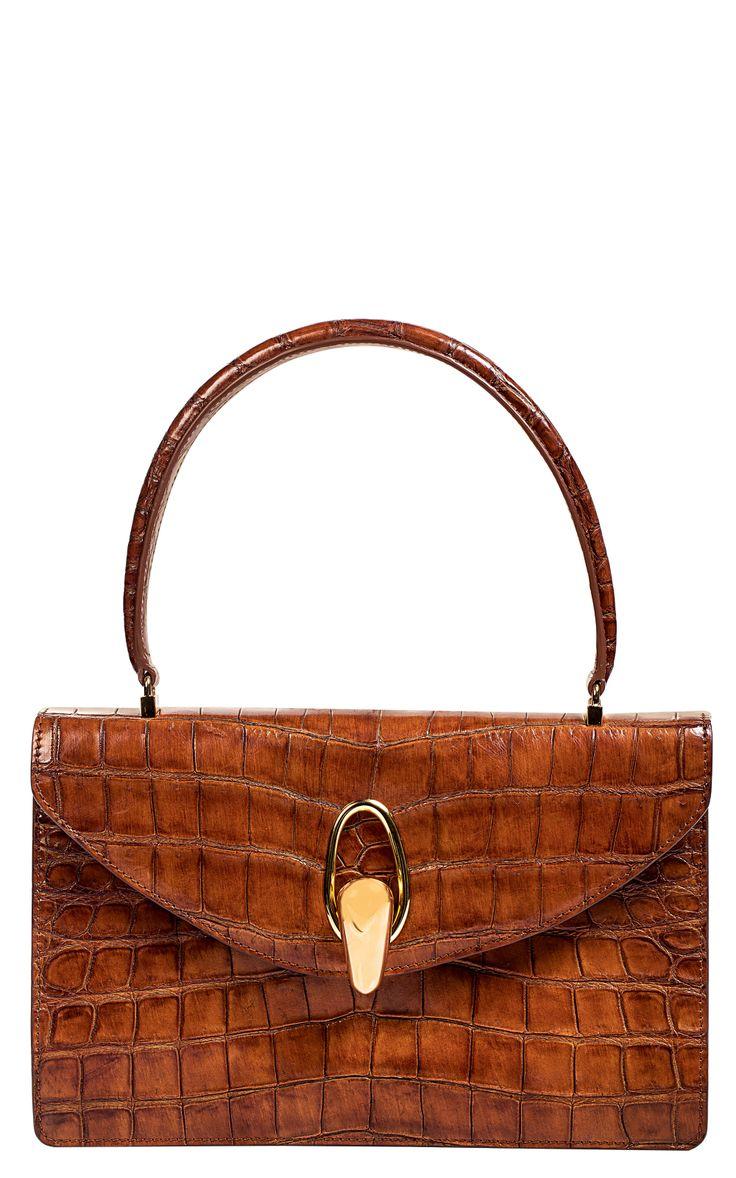 Mini bag with crocodile pattern, Giorgio Armani, price on request; Armani.com