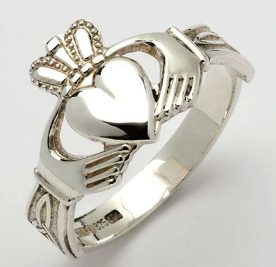 Claddagh Ring... the heart of the Claddagh is a symbol for love, the crown is a symbol of loyalty, and the hands symbolize friendship.
