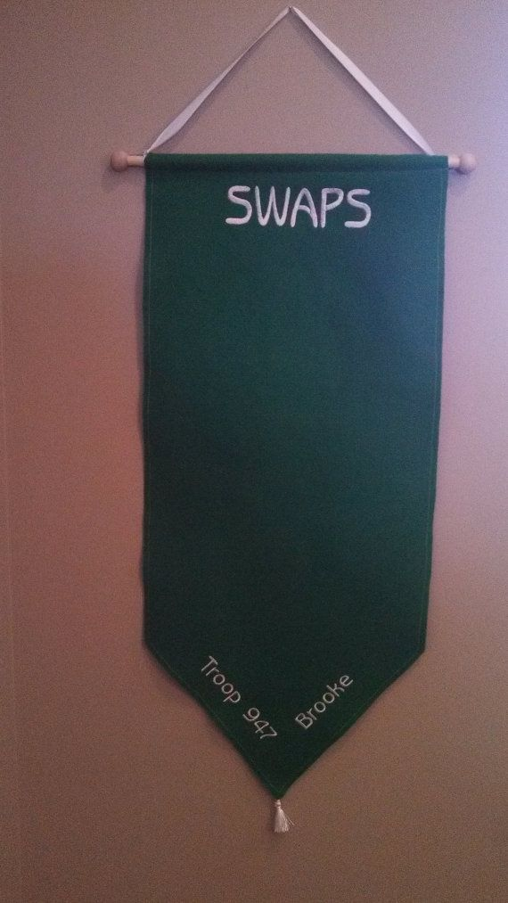 A perfect place for all those items that are swapped between Girl Scout troops! Girl Scout SWAPS Banner made of green felt and embroidered in