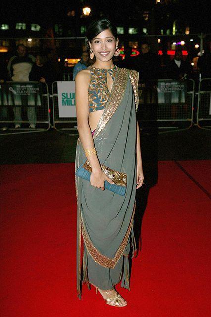 Freida Pinto's sari features a keyhole-neck choli. #refinery29 http://www.refinery29.com/sari-outfits#slide-27