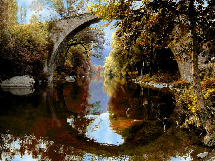 Reflections create a magnificent cycle on the water - Autumn colours spread their beauties all over the scene. Vovousa - Ioannina - GREECE