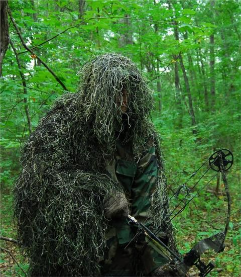 """Synthetic Ultra-Light Ghillie Bow Hunting Jacket Right Hand Woodland 2XL - We use Industrial sewing machines to sew a knotted 1"""" x 1"""" nylon netting directly to a Military BDU 4 pocket coat. These jackets are made by """"ATLANCO"""". Our Synthetic thread is directly hand tied to this netting. The sewn on Synthetic thread covers the entire back of the jacket, half the chest area in the front, one sleeve, and has an attached hood. The open sleeve and chest area is so your bow string won't interfere…"""