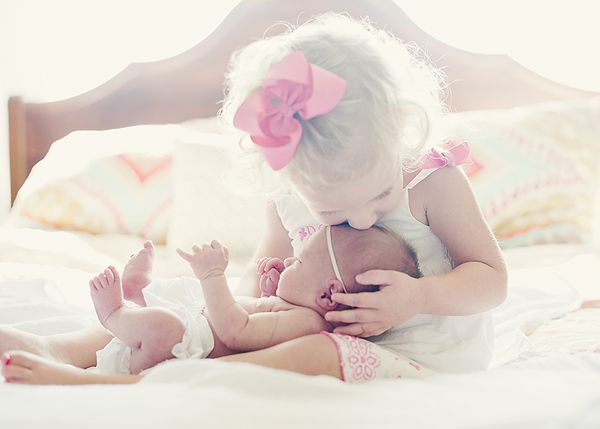 Toddler and newborn! Can't wait to do this with ryleigh & paisley!!