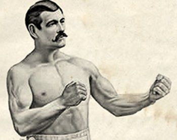 Famous 19th century bare knuckle boxer John L. Sullivan striking a manly fisticuffer pose while sporting an awesome handlebar mustache.
