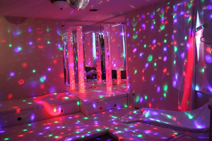 A Snoezelen Room Dim Lights Disco Ball Water Tubes