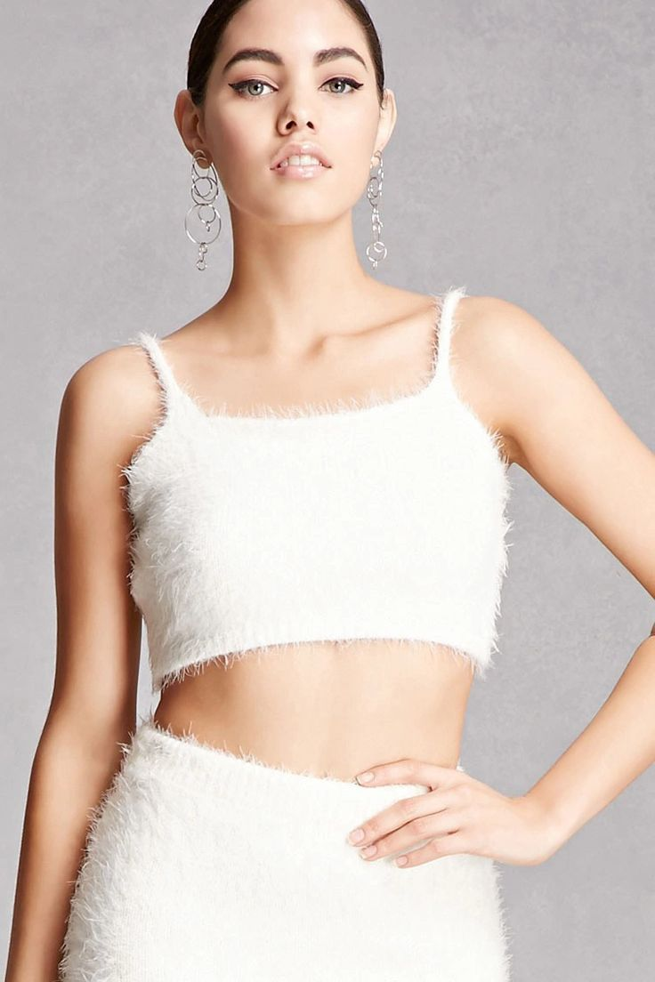 A soft fuzzy knit crop top featuring a scoop neckline, cami straps, and a scoop back. Matching skirt available. This is an independent brand and not a Forever 21 branded item.