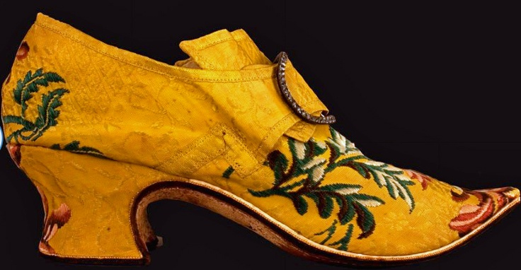 Yellow Brocaded Shoes, 1740-1750,  Buckles, possibly ca.1790; London, England, worn in Maine; Shoes: silk brocaded with silk, leather, linen, paper; buckles: silver, paste stones, steel; shoes made by Thomas Ridout and James Davis Shoemakers, near Aldgate, London. © 2013 The Colonial Williamsburg Foundation
