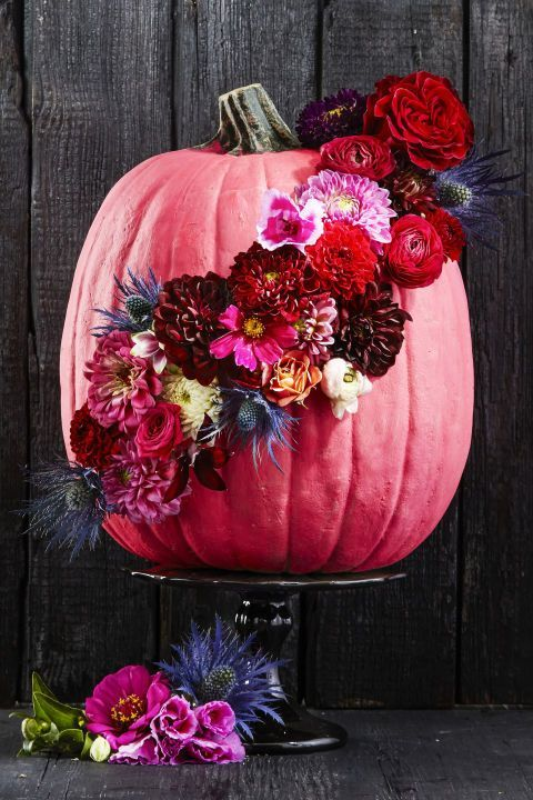 Put a colorful spin on the traditional fall pumpkin: After coating your gourd in a new bright hue, inject some texture with fresh blooms. Full-petaled favorites like chrysanthemums, dahlias and ranunculus will do the trick.  Click through for the tutorial and more painted pumpkin decorating ideas for Halloween.
