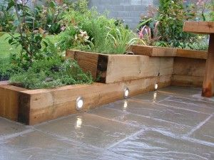 Wonderful Small Patio Garden Ideas with Wooden Planter Box and Floor Lights