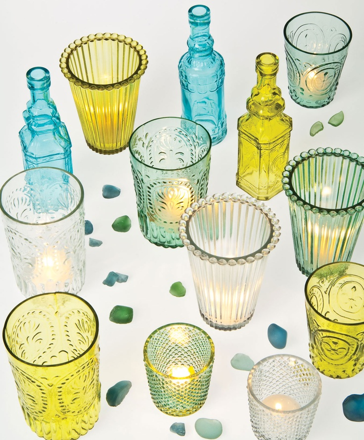 Bottles and tea light holders inspired by vintage styles and sea glass.