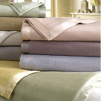 Luxury silk blanket finished with a silk charmeuse border and mitered corners, our silk blankets are great for layering on beds for those colder, chilly nights. #PureSilkBlankets #blanket