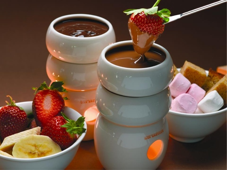 Max Brenner fondue. Try this: Decadently Thick Italian Hot Chocolate. 2 TB butter, 2 tsp Corn Starch, 2 cups whole milk, 4 TB sugar, 1/2 cup milk chocolate chips. 1/2 cup semi-sweet chocolate chips.  Melt butter in pan low heat.  Whisk in corn starch. Turn up heat and add milk and sugar, stirring constantly to thicken it up being careful not to scorch.  Turn down heat. Add all chocolate chips, stir constantly until melted.  Serve with bananas, strawberries, marshmallows, angel food cake.