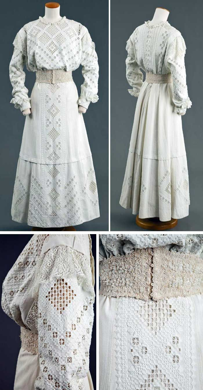 White linen Hardanger-embroidered dress,  ca. 1900-09, and white pearl beaded cincher belt with 5 hook and eye closure. High stand-up collar, long sleeves. Hardanger is a form of embroidery traditionally worked with white thread on white even-weave cloth, using counted thread and drawn thread work techniques. It is sometimes called whitework embroidery. Goldstein Museum of Design, Univ. of Minnesota