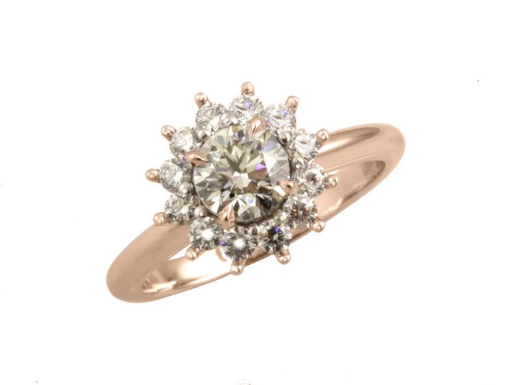 Delicate diamond halo engagement ring in rose and white gold.