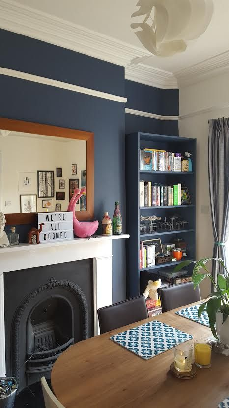 Dulux Breton Blue walls and painted Ikea Billy bookcase (also painted in Breton Blue). MADE Edelweiss dining table.