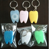 Dental gifts: dental floss on keychains. I think everyone knows sometimes this would come in handy..