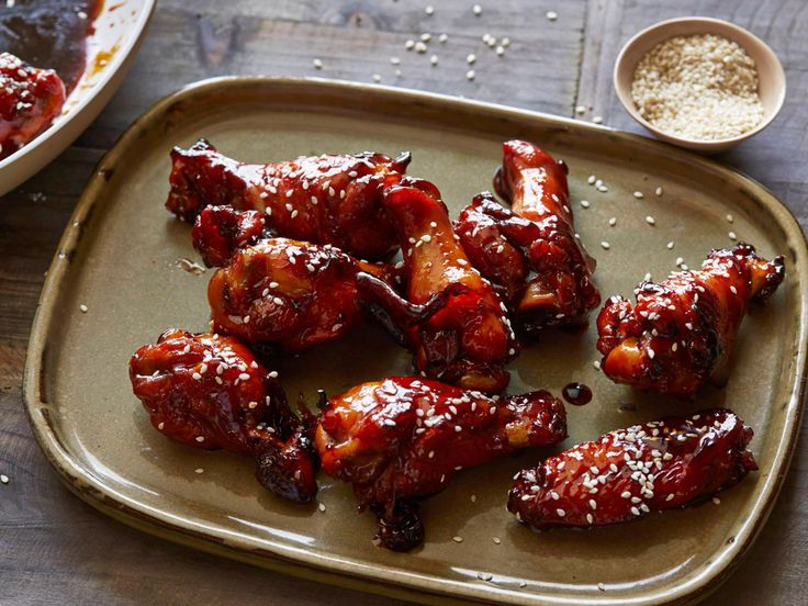 Sticky Honey-Soy Chicken Wings : These honey-and-soy-glazed chicken wings are the perfect hand-held treat for an outdoor party. The nutty flavor of the sesame seeds complements the sweet glaze.