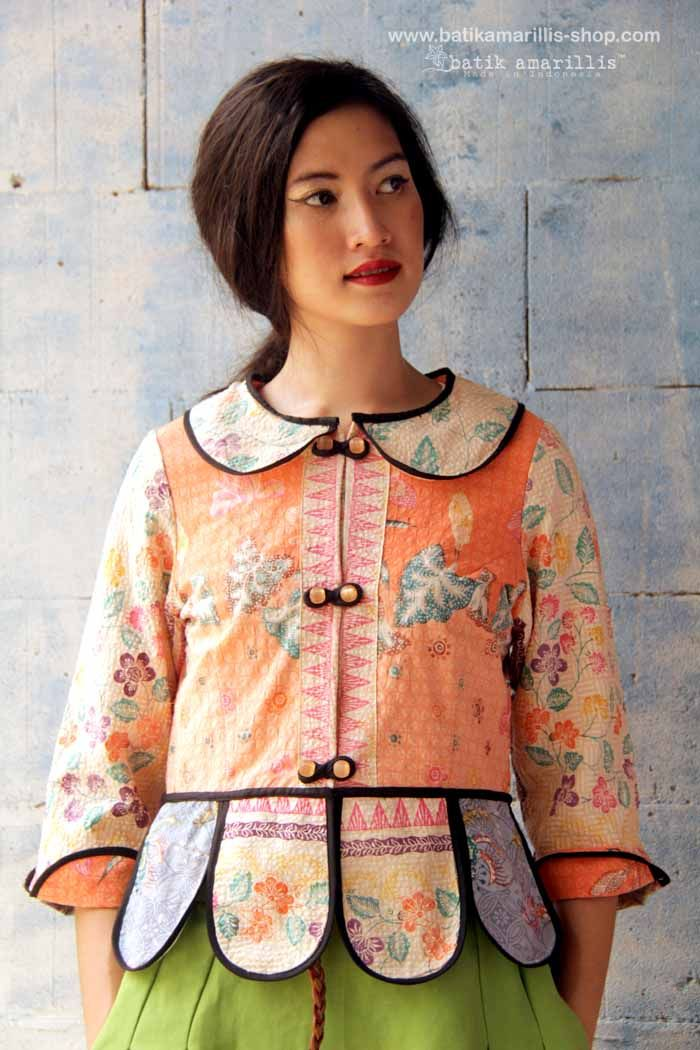 Batik Amarillis' Piccola jacket in sweet pastel shades embossed batik cirebon -Indonesia ..Take a fresh, sweet & whimsical approach to power dressing with this Krakow-Poland classic traditional folklore inspired jacket . The beauty essential is reworked with a contrast-coloured batiks,unique cuttings ,trims,glossy beaded buttons,it has fitted waist with unique peplum petals.