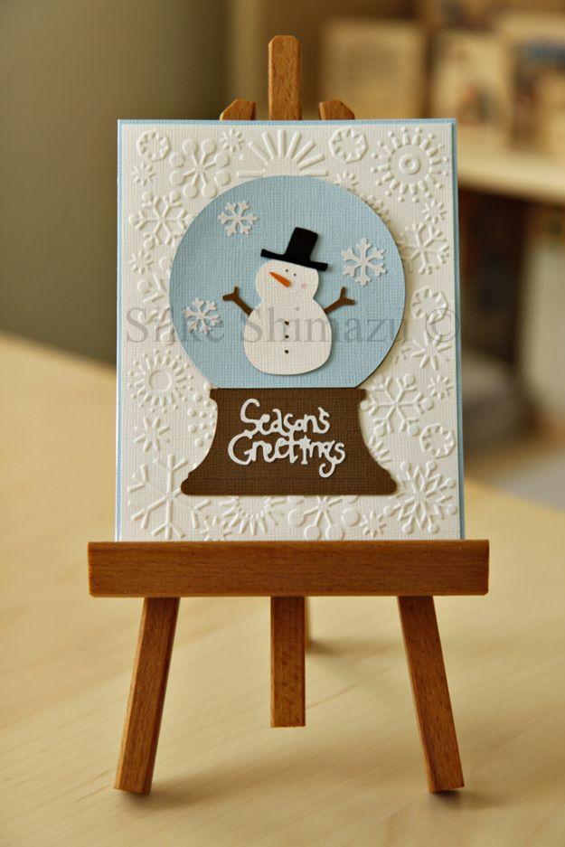 Cricut Christmas card featuring Doodlecharms snowman inside Joys of the Season snowglobe easel shot