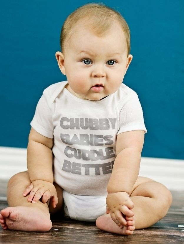 Sporting a funny onesie. It will be even funnier in 20 years.| 29 Photos Every Parent Must Get Of Their Baby