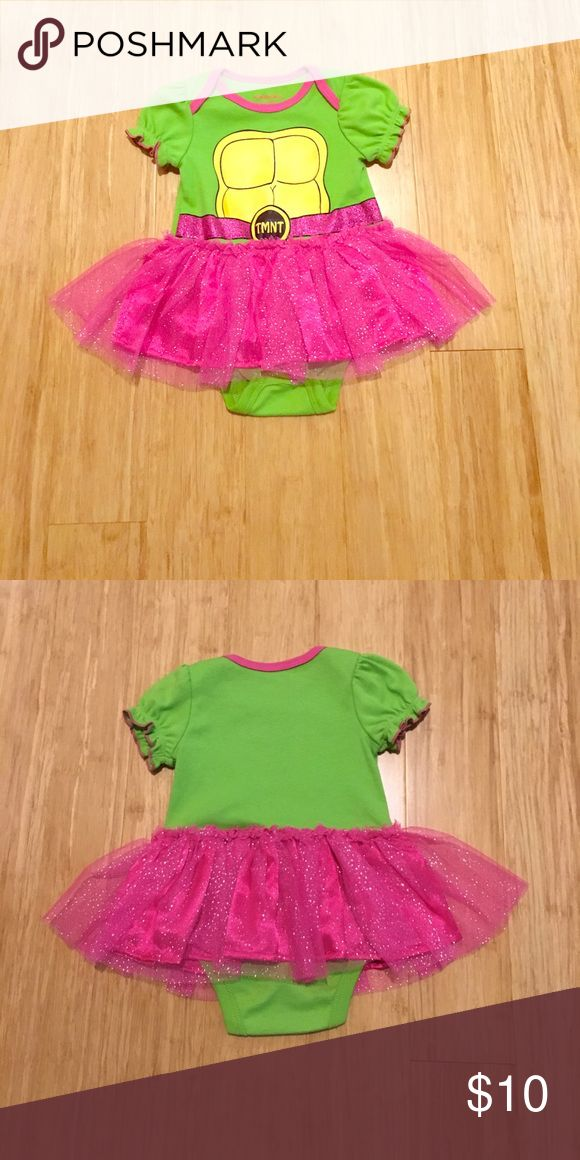 Teenage Mutant Ninja Turtle Onesie w/ Tutu-0-6m Teenage Mutant Ninja Turtle Onesie with Pink Glitter Tutu-0-6m, snaps at crotch, washed, never worn. Nickelodeon product, smoke free home, would make cute costume! One Pieces Bodysuits