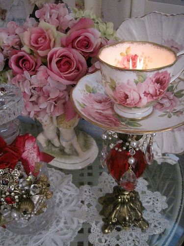 Old Teacup & Saucer and Base...re-purposed into a beautiful rose & pearl tea cup candle stick.