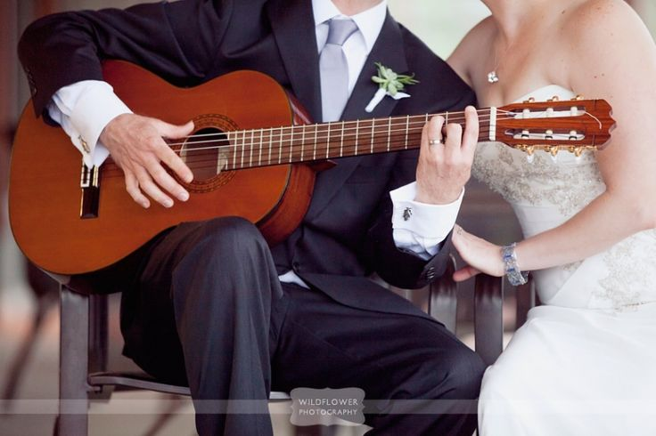 Love this detail photo of the musical bride and groom with a guitar on the outside porch at the Columbia Country Club in MO.  We specialize in rustic and vintage wedding photography throughout the Midwest.  #wildflowerphotography #columbiacountryclub