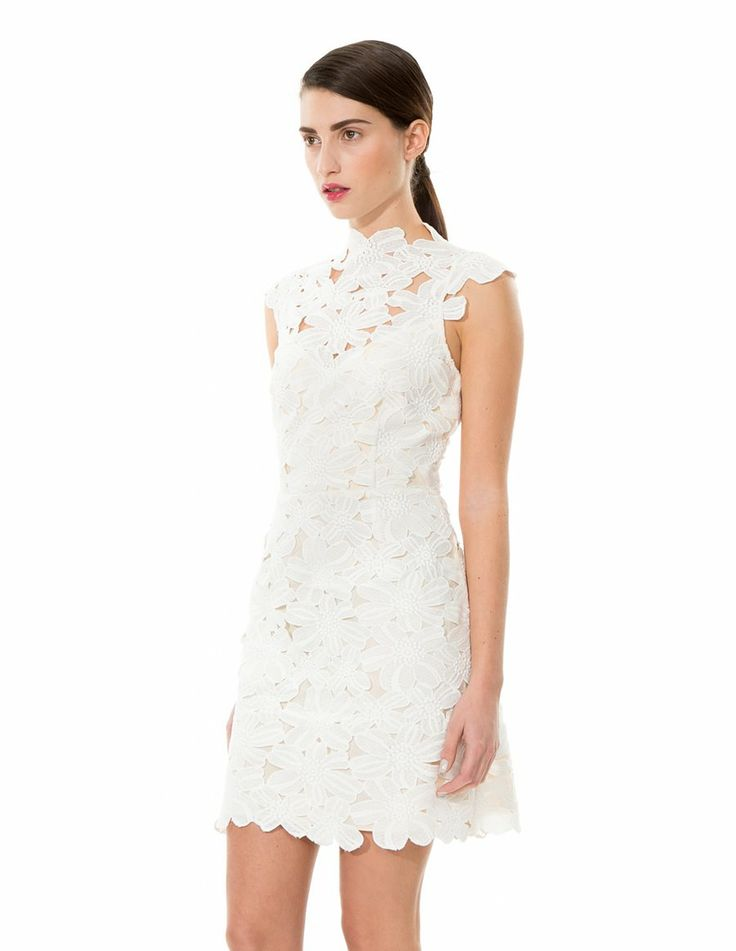 The lace details add delicacy to a plain dress. | Dolce Vita