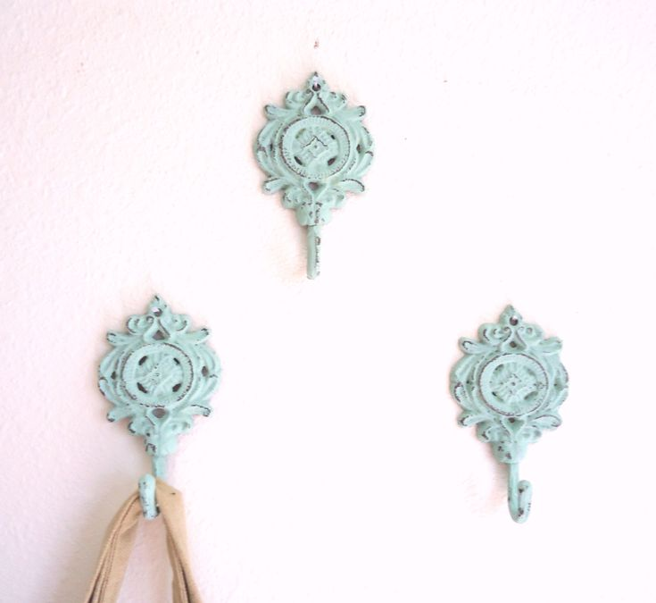 3 Wall Hooks Shabby Chic Decor - Cast Iron - French Country Tiffany Blue Decor- Vintage Home - Ready To Ship. $24.50, via Etsy.