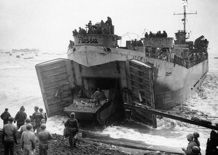Flat Nose Flossie, a Coast Guard manned LST buries its nose in the volcanic sands of Iwo Jima beachh... - AP Photo/U.S. Coast Guard