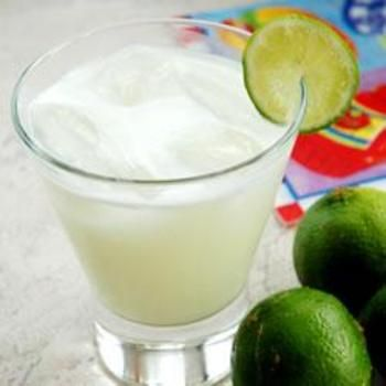 Brazilian Limonade ~ Ingredients  2 limes  1/2 cup sugar  3 tablespoons sweetened condensed milk  3 cups water  ice  Directions  Wash limes thoroughly. Cut off the ends and slice into eight wedges. Place limes in a blender with the sugar, sweetened condensed milk, water, and ice.  Blend in an electric blender, pulsing 5 times. Strain through a fine mesh strainer to remove rinds. Serve over ice.