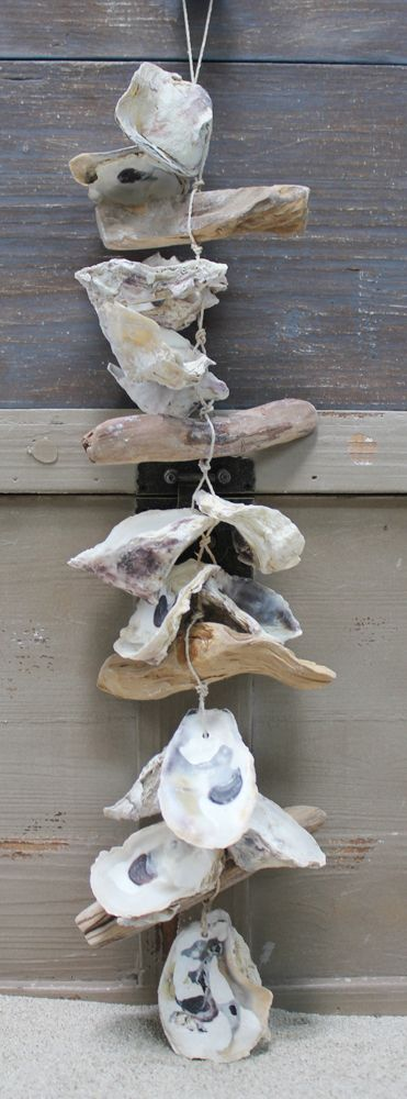 DIY Nautical Driftwood and Oyster Shell Garland, perfect beach house home decor, coastal cottage living #summer #ocean