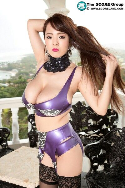 Her Tits Are Tasty In A Shiny Purple Bra