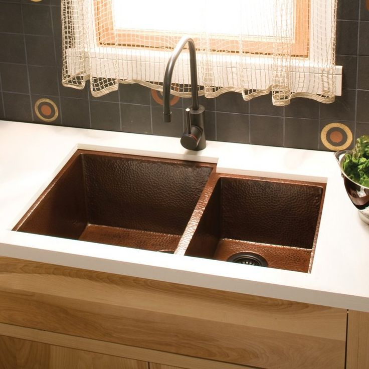A Hammered Copper Sink That Is Undermounted In Design And Features An Unequal Split Of 60