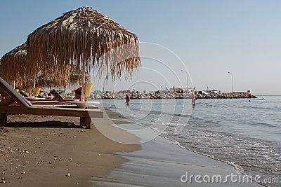 City beach with sun beds and sun umbrellas in the morning. Larnaca. Cyprus…