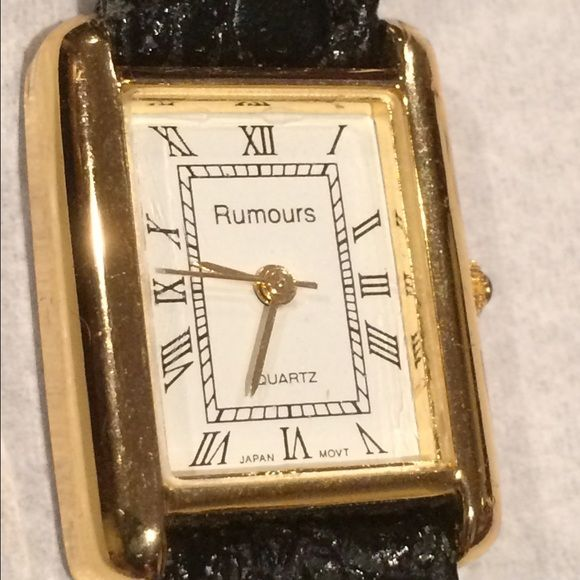 Watch - wrist watch by Rumours Quartz. Leather. Watch - wrist watch by Rumours Quartz. Roman Numeral. Needs a new battery that costs roughly $10. Leather Band. Fits 5 1/2 - 7 inches. Rumours Accessories Watches
