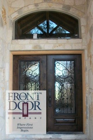 Double Front Door With Iron And Bubble Glass Interior